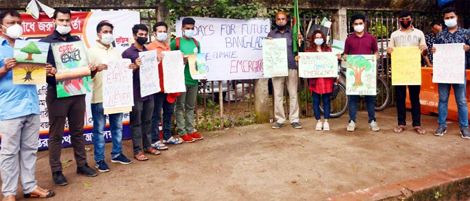 Organizers of Fridays for Future Bangladesh forms a human chain in front of the Jatiya Press Club on Friday to realize its 8-point demands marking Global Day for Climate Action.