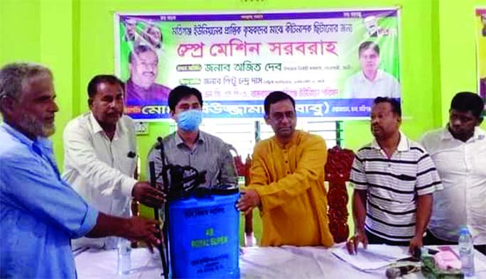 Sonagazi UNO Ajit Dev along with Motiganj UP Chairman Rabiuzzaman Babu distribute spray machines among farmers at a ceremony held in the auditorium of Motiganj sub-registrar office on Saturday.