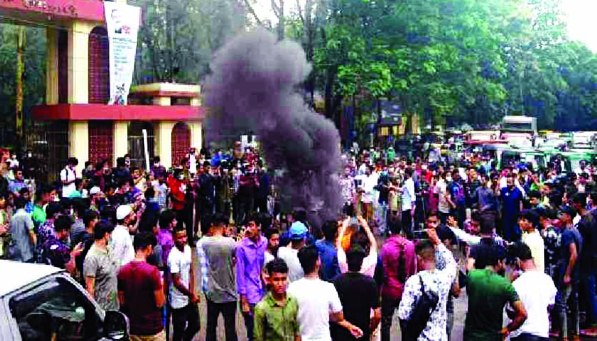 Students stage demonstrations in front of Sylhet MC College on Saturday, protesting the rape of a woman at the dormitory.