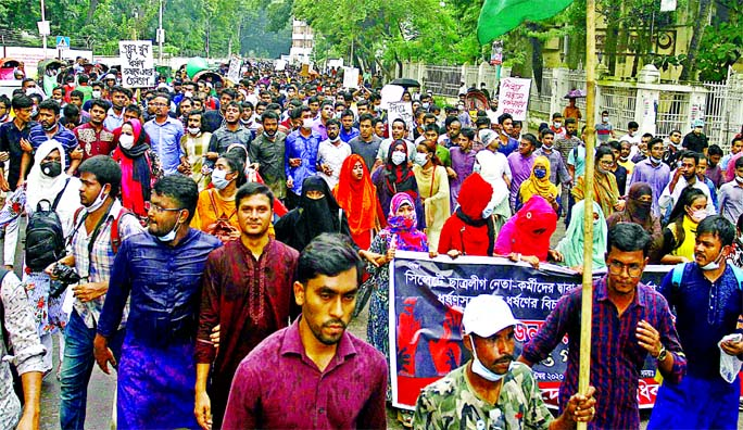 Bangladesh Chhatra Odhikar Parishad stages a demonstration on Dhaka University campus demanding trial of gang-rapes in Sylhet and Khagrachhari on Wednesday.