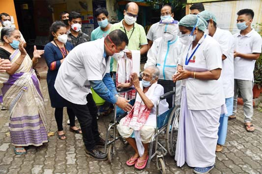 The faces of India's coronavirus pandemic as deaths hit 100,000
