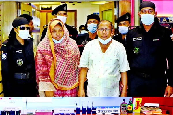 RAB personnel produce Md Imam Hossain Nasim, owner of Nasim Real Estate and his assistant Halima Akter Salma before media on Thursday after their arrest from capital's Rupnagar area for fraudulent activities.
