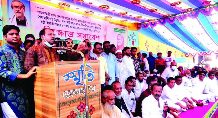 Bogura Municipal Awami League President and Gabtoli Upazila Chairman Rafi Newaz Khan Robin speaks at an anti-rape rally at Gabtoli Pilot High School field on Sunday.