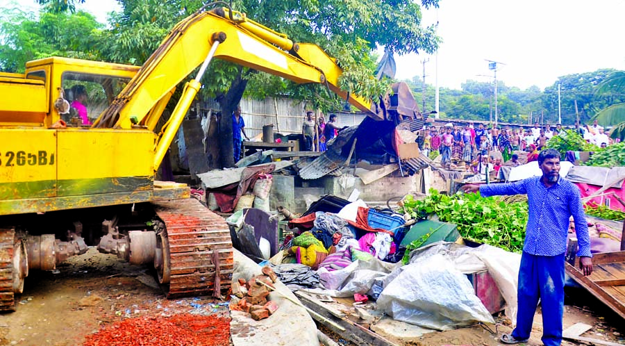 The Railway authorities conduct an eviction drive against illegal encroachers at  Ambagan in Chattogram City on Monday.