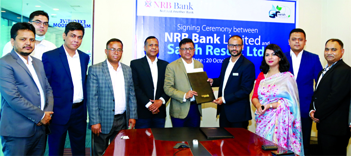 Mamoon Mahmood Shah, Managing Director of NRB Bank Limited and Ahmad Raquib, General Manager of Sara Resort (a sister concern of Fortis Group Limited), exchanging documents after signing an agreement at the bank's head office in the city on Tuesday. Under the deal, Debit and Credit cardholders of the bank will get 25 percent discount on room at the resort. Top officials from both sides were also present.