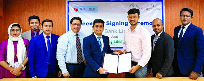 Md. Kamruzzaman, Head of Retail Banking of ONE Bank Limited (OBL) and Shahed Azaz Ahmed, Managing Director of Hotel Tropical Daisy, exchanging agreement signing documents at the banks head office in the city recently. Under the deal, OBL Credit, Debit and Prepaid card holders will enjoy 50% discount on room rent, 15% discount on all food items and 10% discount at coffee corner round the year. Top officials from both the organizations were also present.