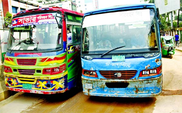 Two buses engage in a race to overtake each other on Naya Paltan road in the capital on Monday defying traffic rules.