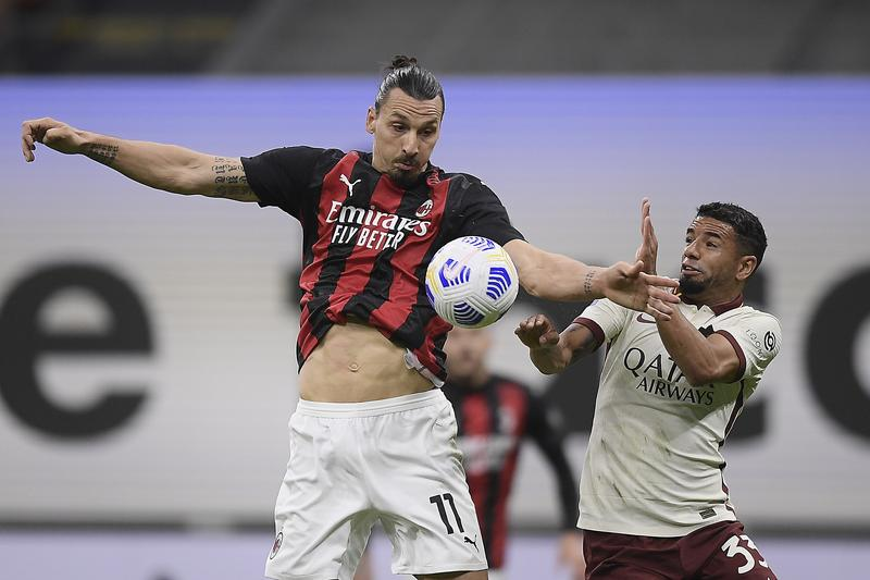 Roma hit back three times to hold leaders Milan