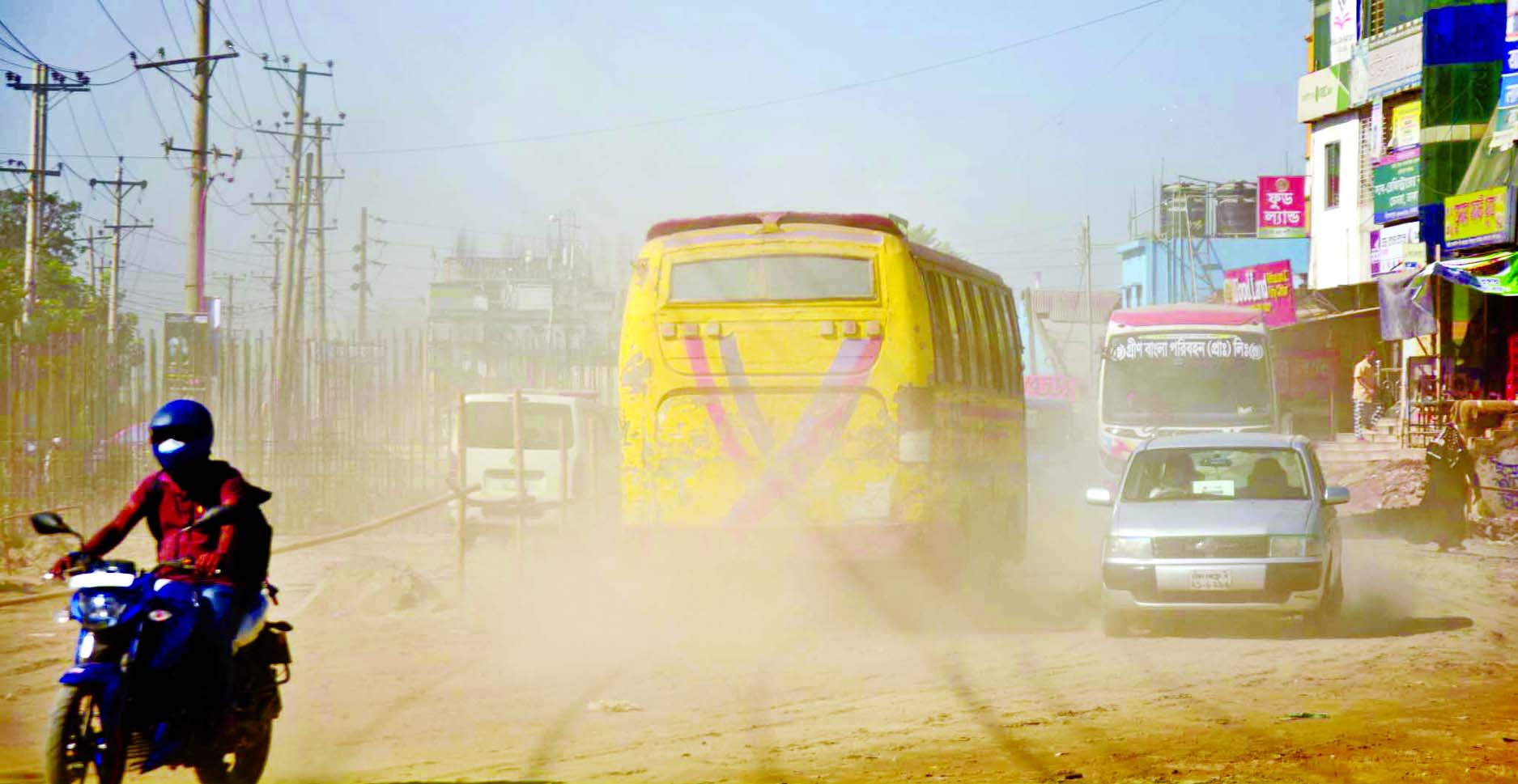Thick layer of dust makes the Dhaka-Sylhet Road at ...