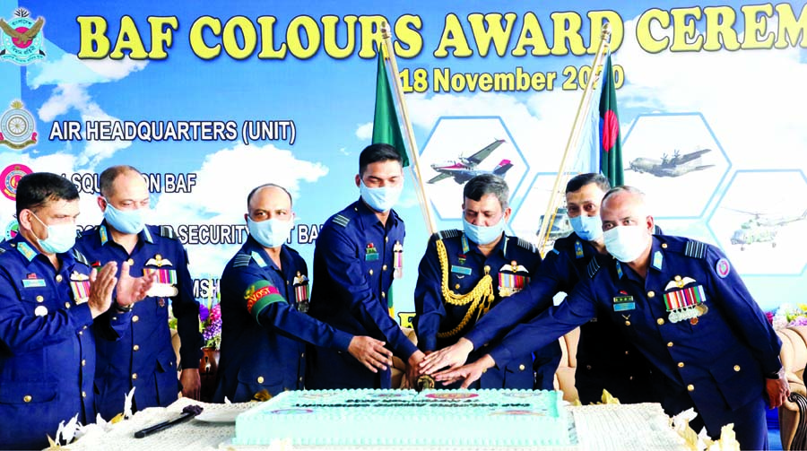 Chief of Air Staff Air Chief Marshal Masihuzzaman Serniabat cuts cake at the BAF Colours Award Ceremony of different units and squadrons of BAF at the parade ground of BAF Base Bashar on Wednesday.