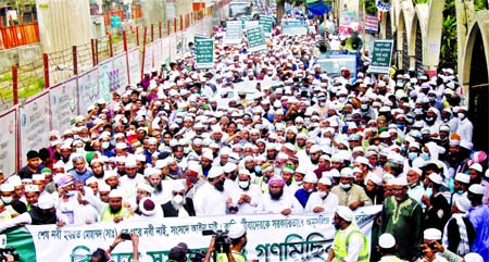 Different organisations stage a demonstration in the city`s Baitul Mokarram area on Friday in protest against publishing caricature picture of the Prophet Hazrat Mohammad (SM) and demanding declaration of Kadiani as non-Muslim.