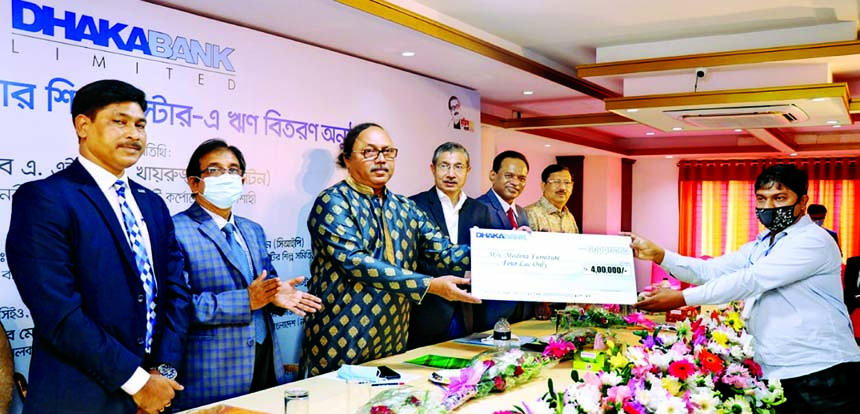 AHM Khairuzzaman Liton, Mayor of Rajshahi City Corporation, distributing Rajshahi Furniture Cluster loans on behalf of Dhaka Bank as chief guest at a function held at a local auditorium in Rajshahi on Sunday.  Emranul Huq, Managing Director and CEO of Dhaka Bank Limited, Md. Sultan Masud Ahmed, Executive Director, Bangladesh Bank, Rajshahi, Md. Iftekhar Ali Babu, Central Co-President of National Small and Cottage Industries Association Bangladesh (NASEB), Md. Moniruzzaman, President of Rajshahi Chamber of Commerce and Industry and local elites were present.