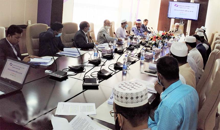 Professor Md. Mozahidul Islam Chowdhury, Chairman of the Shari'ah Supervisory Committee of Union Bank Limited, presiding over a meeting on Monday at its head office. A B M Mokammel Hoque Chowdhury, Managing Director of the bank and other members of the committee were also present.