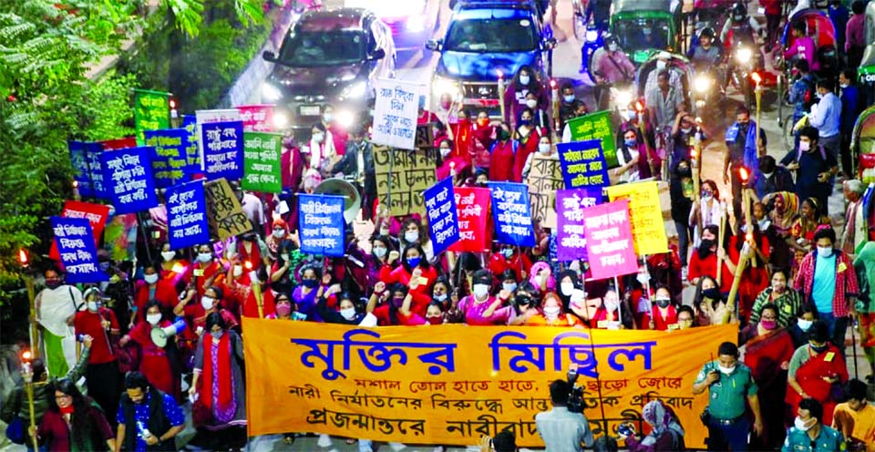 Women's rights activists bring out a procession in the capital's Dhanmondi area on Wednesday evening, marking the International Day for the Elimination of Violence against Women.