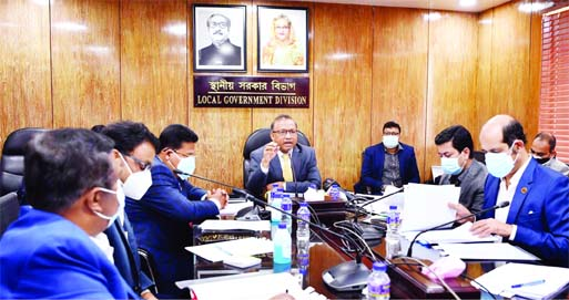 LGRD and Cooperatives Minister Tajul Islam presides over a meeting on handing over responsibility to sewer rain water to DNCC and DSCC from Dhaka WASA at the conference room of LGD on Thursday with a view to eradicating water logging from Dhaka city.