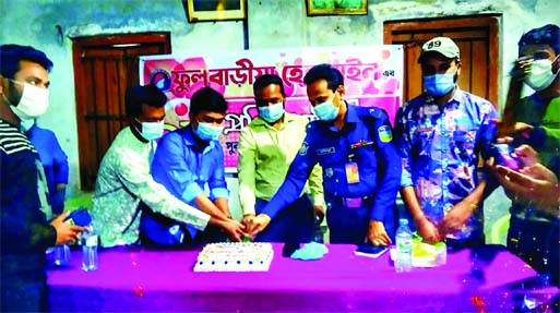 Mymensingh's Fulbaria UNO Asraful Siddique cuts a cake on Wednesday marking the second anniversary of Fulbaria Helpline.