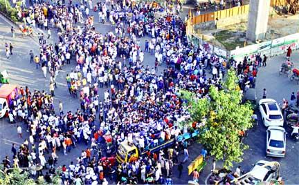 Muktijuddha Mancha holds a rally blocking Shahbagh intersection in the capital on Saturday demanding legal actions against Hefazat-e-Islam leader Mamunul Haque and Islami Andolan Bangladesh senior vice-president Syed Mohammad Faizul Karim.