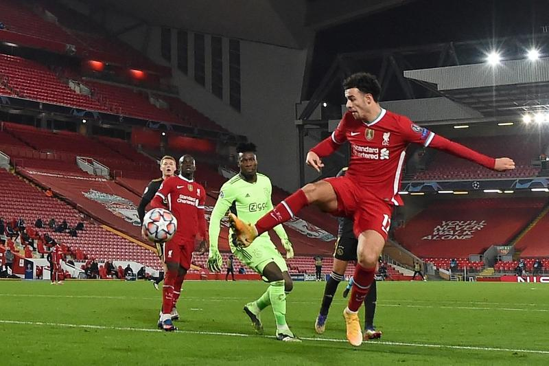 Liverpool's midfielder Curtis Jones (right) scores the opening goal during the UEFA Champions League, Group D football match against Ajax at Anfield in Liverpool, north west England on Tuesday.