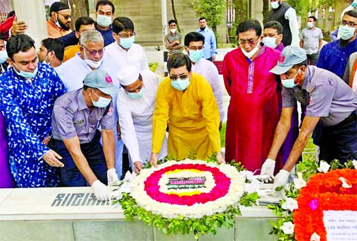 DSCC Mayor Barrister Sheikh Fazle Noor Taposh along with others pays floral tributes at the grave of founding Chairman of Juba League Sheikh Fazlul Haque Moni at Banani Graveyard in the city on Friday marking the latter's 81st birthday.