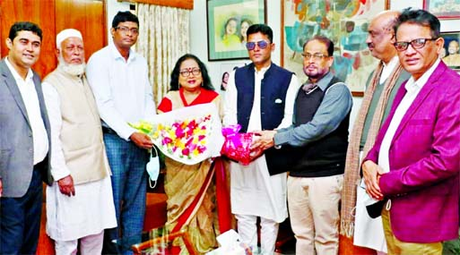Former Organizing Secretary of Lalmonirhat Juba League Rabiul Islam Basunia joins Jatiya Party giving bouquet to the party Chairman GM Kader, MP at the party office in the city's Banani on Friday.