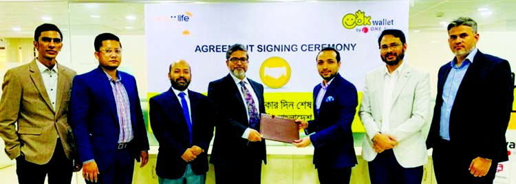 Gazi Yar Mohammed, Head of MFS & Agent Banking of ONE Bank Limited and MM Monirul Alam, Managing Director & CEO of Guardian Life Insurance Limited, exchanging an agreement signing document at the bank head office in the city recently. Under the deal, both parties will work together towards removing cash friction and building digital eco system. OK Wallet customers will be able to purchase different insurance products and pay insurance premium of Guardian Life Insurance from OK Wallet App.  High officials from both organizations were also present.