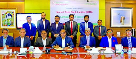 Khwaja Shahriar, Managing Director & CEO of LankaBangla Finance Limited (LBFL) and Syed Mahbubur Rahman, Managing Director and CEO of Mutual Trust Bank Limited (MTBL), exchanging a MoU signing document at the bank head office in the city recently. Under the deal, LBFL Mastercard Titanium & VISA Platinum card members will enjoy free access with entertainment in MTB Air Lounge at Hazrat Shahjalal International Airport, Dhaka, Shah Amanat International Airport, Chattogram and Osmani International Airport in Sylhet from 1st January 2021. High officials from both organizations were present.