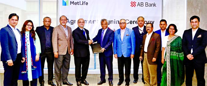 Tarique Afzal, Managing Director of AB Bank Limited and Asif Shams, Director of MetLife, exchanging an agreement signing document at the bank head office in the city on Monday. Under the deal, bank's Nishchinto Fixed Deposit Account holders will enjoy Life Insurance coverage up to Tk80 lakh from MetLife free of cost. Senior officials from both the organizations were also present.