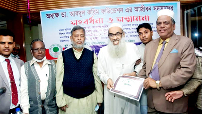 Chairman of the Parents Care School and college Principal Dr. Abdul Karim seen handing life membership certificate and felicitation to the members of the foundation in the reunion function.