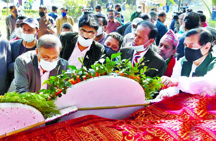 Information Minister Dr. Hasan Mahmud pays floral tributes on the coffin of novelist Rabeya Khatun on Bangla Academy premises in the city on Monday.