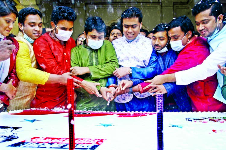 BCL President Al Nahiyan Khan Joy, along with other leaders cuts cake on the premises of Curzon Hall of Dhaka University on Monday marking the 73rd founding anniversary of the organisation.