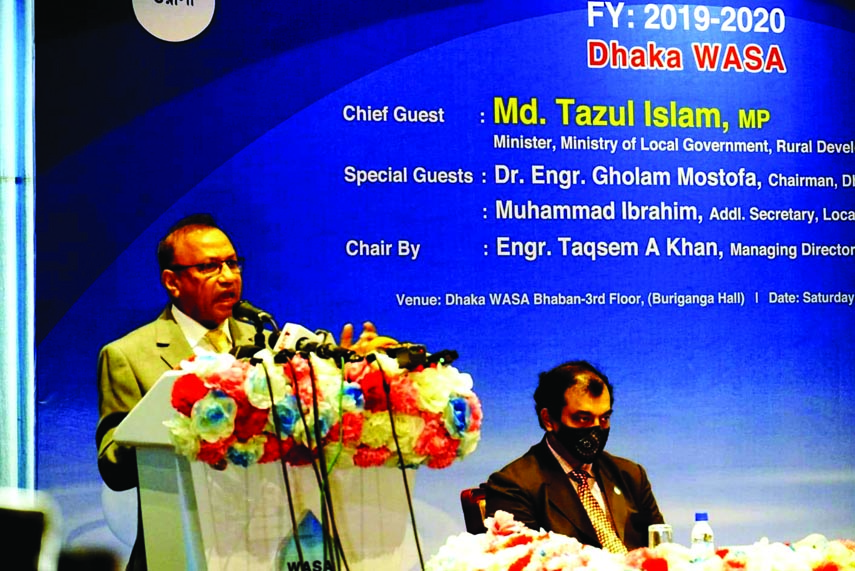 LGRD and Cooperatives Minister Tajul Islam speaks at the bill collection award  distribution to Government and non-government banks at Dhaka WASA Bhaban on Saturday.