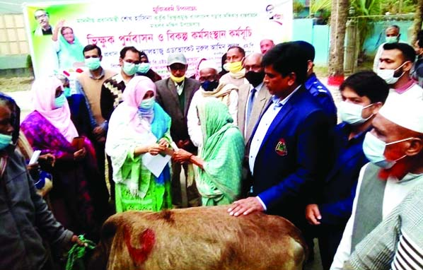 UNO Fahmida Huque is seen handing over nine cows and cash Tk 8, 760 to each of nine beggars of 9 Wards in Matlab Paurasava at a simple ceremony held at Matlab Upazila in Chandpur as a gift of Mujib Borsho on Monday last.