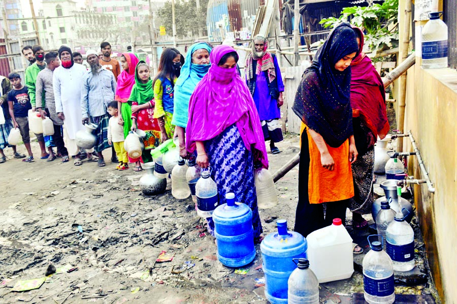 Residents of Jatrabari's Chhantak in the city collecting drinking water  from deep tube well  since the WASA water is polluted. The photo was taken on Sunday.