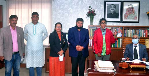 Hamida Akhter Jeba (second from right), a student of MBA Department of Dhaka University showing her gold medal at the Dhaka University's Vice-Chancellor office room on Monday. Jeba won gold medal and Taka 5 lakh in the women's category of the Bangabandhu Sheikh Mujib Dhaka Marathon Competition recently. Vice-Chancellor of Dhaka University (DU) Professor Dr Md Akhtaruzzaman, President of DU Athletics Committee and General Secretary of DU Teachers Association Professor Dr Nizamul Hoque Bhuiyan, Director of the Physical Education Centre Md Shahjahan Ali were present, among others.