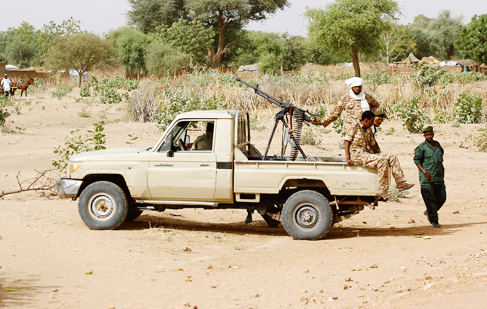 A convoy of Sudanese security forces deploy during a rally in al-Geneina, the capital of the West Darfur state.