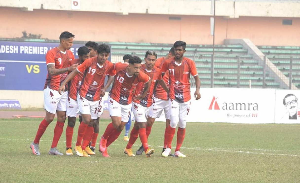 Players of Bashundhara Kings celebrate during the match of the Bangladesh Premier League Football at the Bangabandhu National Stadium on Tuesday. Bashundhara Kings win the match2-1 against Police FC.