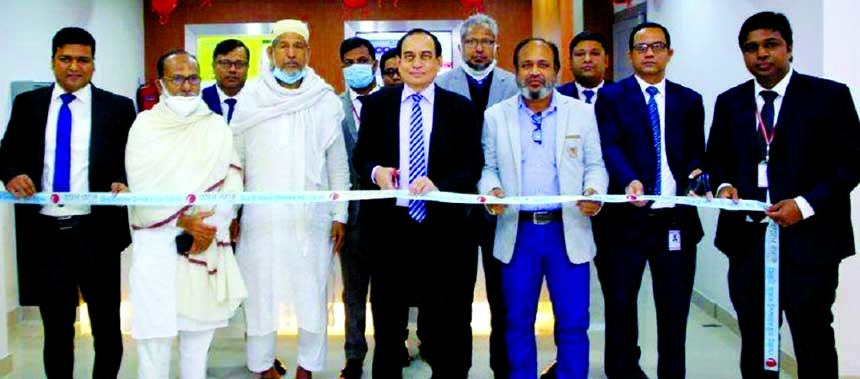 M. Fakhrul Alam, Managing Director of ONE Bank Limited, inaugurating its sub-branch at Zirani Bazar in Ashulia in Savar on Wednesday. High officials of the bank and local elites were also present.