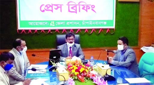 Chapainawabganj DC Md. Manjurul Hafij speaks at a press briefing over the distribution of the houses to landless families at the DC conference room on Thursday.