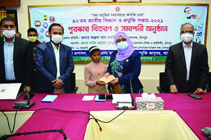 Chandpur DC Anjana Khan Majlish handing over cash money to struggling little girl Kulsum for the help of her sick parents at a simple ceremony on Wednesday.