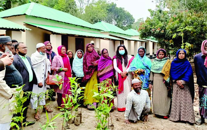 Gazipur's Sripur UNO hands over keys of homes to 10 landless and homeless families in the upazila's Udoykhali village under Telihati union on Wednesday as a gift from Prime Minister Sheikh Hasina marking the birth centenary of Father of the Nation Bangabandhu Sheikh Mujibur Rahman.