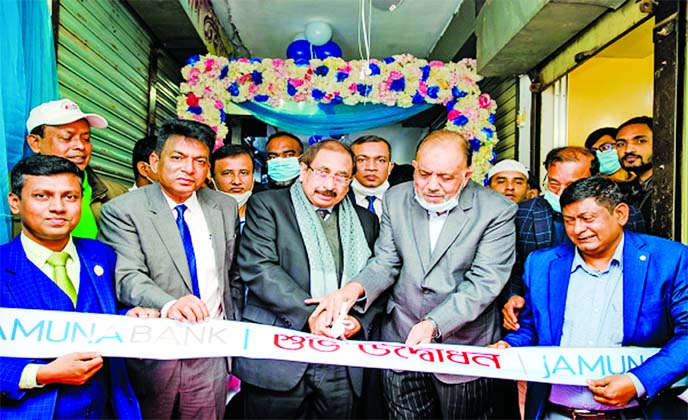 Fazle Quayum, SEVP & Chief Risk Officer of Jamuna Bank Limited, inaugurating its Agent Banking Outlet at Khilkhet Bazar in the city recently.  Ashim Kumer Biswas, EVP & CFO, Sk. Rafejul Islam, Head of Agent Banking Division, other high officials of the bank and local elites were also present.