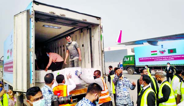 Workers unload a pickup van that carries Oxford-AstraZeneca Covid-19 vaccines which arrived from India as a gift to Bangladesh, in Dhaka, Bangladesh on Thursday.