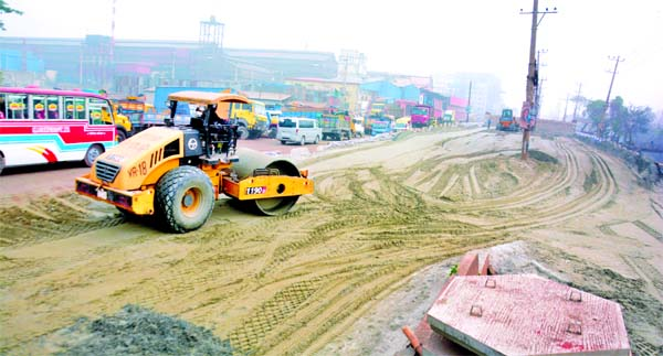 The construction work of Dhaka-Sylhet 4-lane Highway goes on in full swing  at Katherpool area of Jatrabari in the capital on Friday.