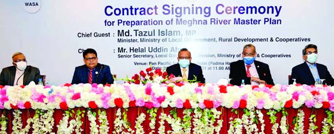 LGRD and Cooperatives Minister Tajul Islam, among others, at the contract signing ceremony for the preparation of Meghna River Master Plan at Hotel Sonargaon in the city on Saturday.