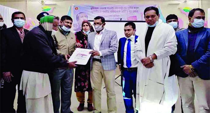 Rana Mohammad Sohel, MP, hands over documents of home to a homeless person at a ceremony held in the Jaldhaka upazila auditorium in Nilphamari on Saturday morning. A total of 191landless and homeless families of the upazila received shelters as a gift from Prime Minister Sheikh Hasina on the occasion of the 'Mujib Barsho'