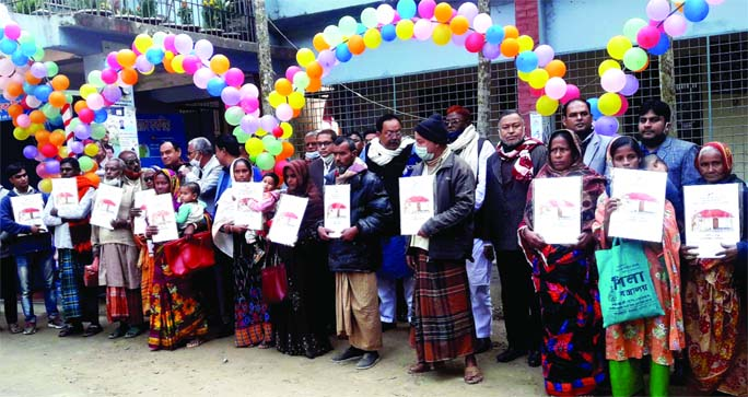 A total of 165 homeless and landless families in Phulbaria Upazila in Kurigram received homes on Saturday as a gift from Prime Minister Sheikh Hasina on the occasion of the 'Mujib Barsho'. The beneficiaries are seen showing the documents of the homes in this photo.