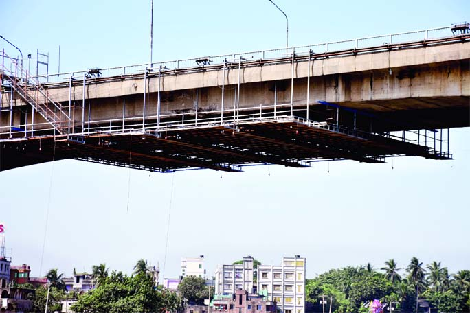 The Buriganga Postogola Bridge damaged by rescue vessel 'Prottoy' has been repaired by steel bars. This photo  was taken on Saturday.