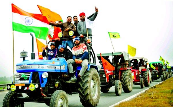 Indian farmers ride caravan of tractors into capital ahead of Republic Day