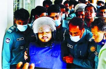 Police escort a convict from a Dhaka court following verdict in blogger Avijit Roy murder case on Tuesday