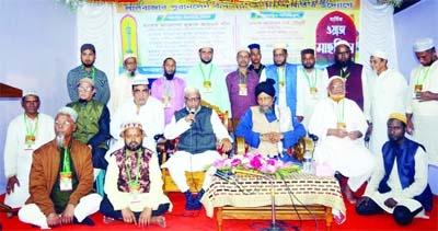 Sylhet City Corporation (SCC) Mayor Ariful Haque Chowdhury speaks at a Waz Mahfil organized by Lalbazar Puranlane Baboshayee Kalyan Samity in Bandarbazar in the city yesterday.